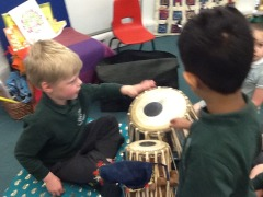 playing Indian drums