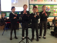 Pupils perform in assembly